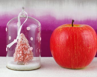 Small glass cloche with Christmas tree and glitter snow.
