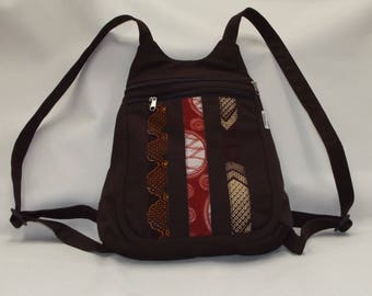 a little chocolate backpack decorated with African fabric tape