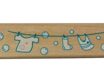 A wooden birth cloth pattern stamp