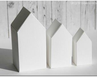 Trio of white houses made of paper (A decorating or not)