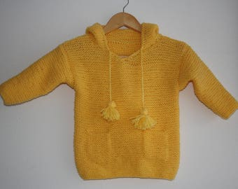 Knitted children's sweater with hood