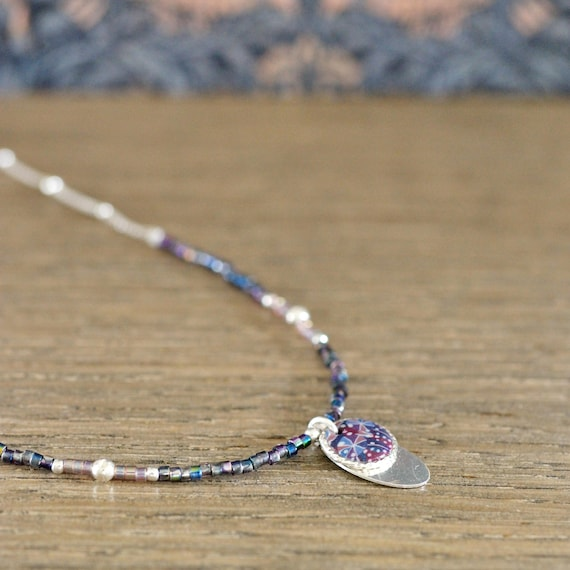 Sterling silver purple necklace 'Ancolie' with blue patterned polymer clay cabochon on silver medal and miyuki beads