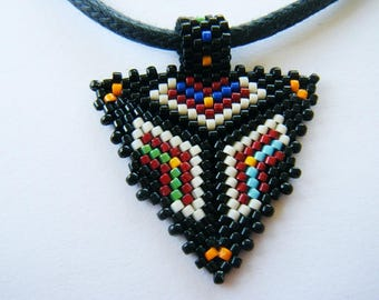 """Tribal"" woven pendant, multicolor geometric pattern black background on leather lace"