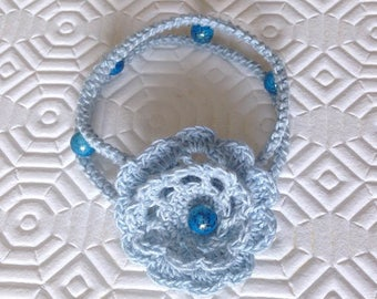 Blue bracelet with crochet rose