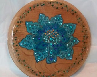 """Blue lotus flower woodburned on 8"""" cherry round, painted and embellished with crystals"""