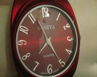 Geneva Watch Red Rubber Coated Metal Cuff Band Womans Quartz Watch Red Face Silver Tone Numbers And Hands