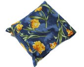 pack of cigarettes and lighter in floral fabric