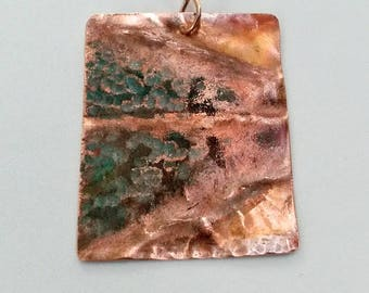 Trees along water fold formed copper patina pendant necklace