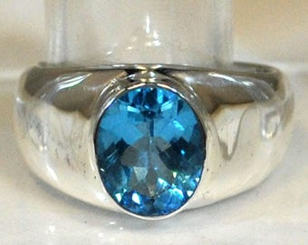 Sterling silver ring with blue topaz setting