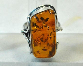 Sterling silver ring with amber setting