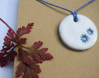 White porcelain necklace with blue modern flower detail