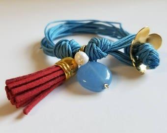 Red pompon bracelet