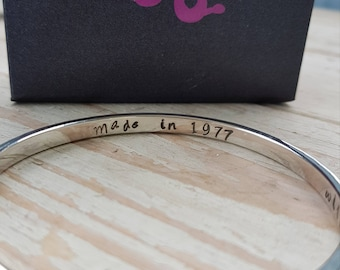 Personalised sterling silver hammered bangle with hidden hand stamped message