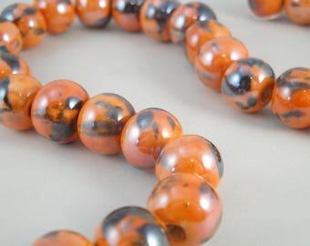 14 ceramics pearls 14 mm X 11 mm : orange mottled