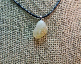 citrine pendant with silver tone bale and 18 in. starter necklace