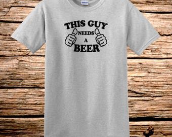 This Guy Needs A Beer Thumbs Gray T-Shirt  Black Logo