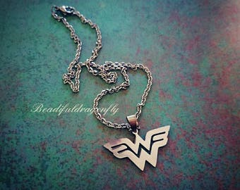 "Stainless Steel Wonder Woman Necklace Comes with 18"" or  20"" Chain. WW Charm is approximately 1.5""x1"" in size."