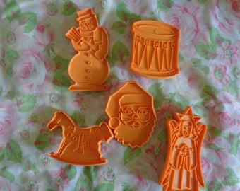 vintage stanley home products set of 5 orange plastic christmas cookie cutters of snowman santa angel