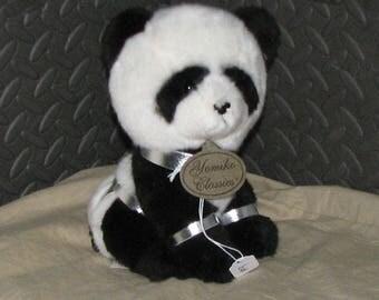 Panda in silver leather