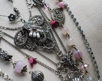 Antique silver (possibly sterling) filigree shoe-clip, antique pink glass rosary beads and rhinestone multi-strand necklace