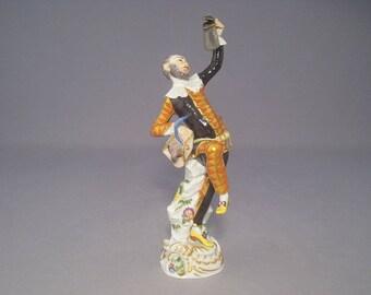 Meissen figurine Comedian Harlequin with a jug
