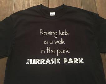 Raising kids is a walk in the park. Jurassic Park/funny mom shirt/funny dad t-shirt/dinosaur shirt