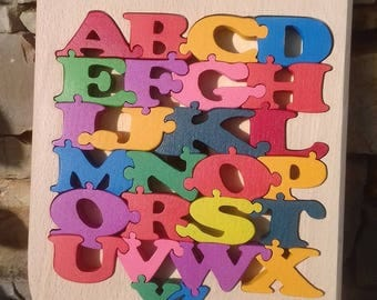 Puzzle comes in a storage coffert solid wooden alphabet