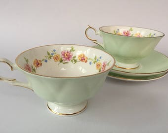 Set of two vintage Springfield teacups with saucers, bone china England, mint green teacups with flower pattern