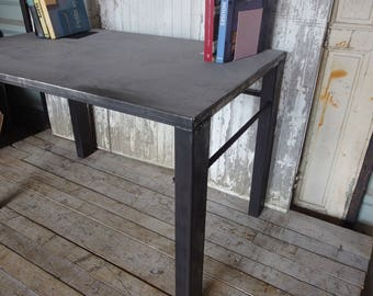 Furniture in raw industrial concrete and steel