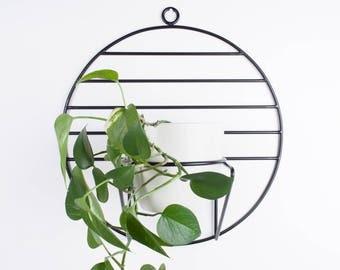 Sol- hanging plant holder