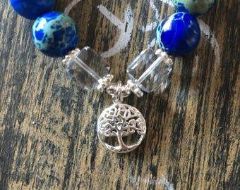 Sea sediment jasper and sterling silver tree of life charm