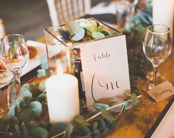 Hand lettered calligraphy wedding table numbers, table names
