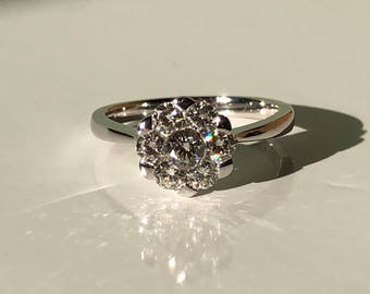 A 18k (stamped 750) White Gold Cluster Engagement ring G Colour SI Clarity