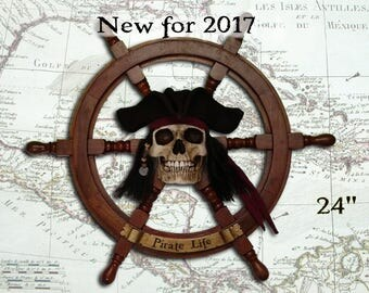 Pirate Skull mounted on Replica Ship's Wheel