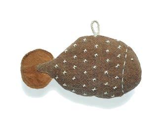 kakifish,ni,a stuffed fish toy made of Kakishibu dyed fabric,柿渋染の布でできた魚のぬいぐるみ