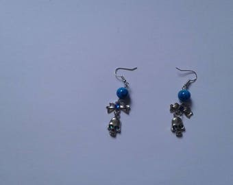 skull and blue pearl earrings