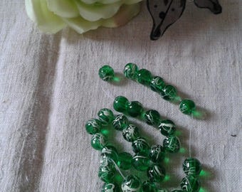 set of 10 white marbled green beads