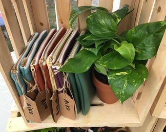 Eco friendly vegan leather pouch. Makeup bag.