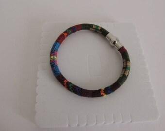 Ethnic man mounted on magnetic bracelets.