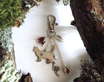 Silver plated bag charm: cat, red glass beads, silvered flanges branch.
