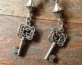 Rustic antique key earrings on copper ear wires.