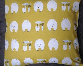 cushion with white polar Bears and a mustard background