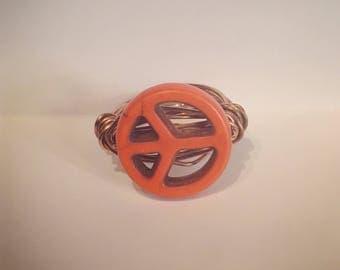 Orange peace sign ring