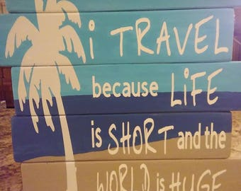 I travel because life is short sign