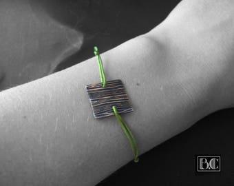 Lime green cord ormolu medallion pattern bracelet wood