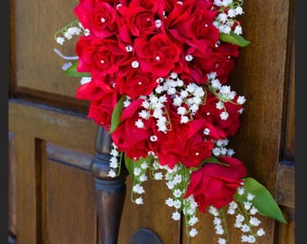 Red Roses with white lilies of the valley cascading bouquet