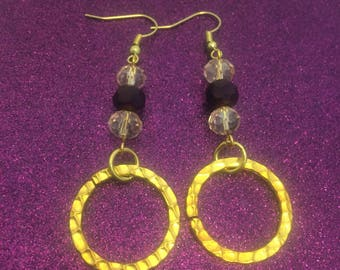 Gold ring and purple bead earrings