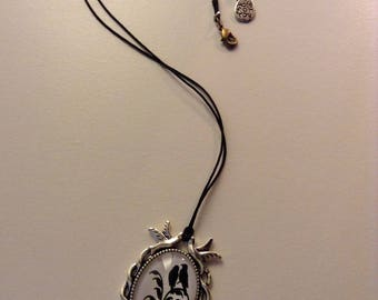 Black and white fantasy bird necklace