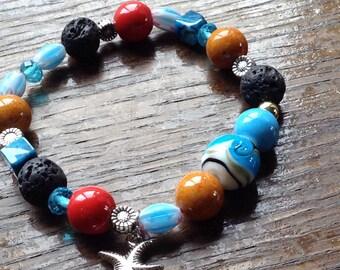 Charmed, lava stone, Jasper, ceramic stretch bracelet