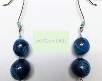 Dangling earrings with shades of blue beads